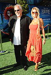 """John Ratzenberger and date at the World Premiere of Disney Pixar's """" Brave """" at the grand opening of the Dolby Theatre Los Angeles, CA. June 18, 2012"""