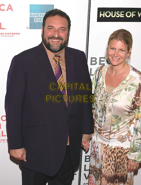 "JOEL SILVER & KARYN.Premiere of his new film, ""House of Wax"", at the Stuyvesant High School,  part of the Tribeca Film Festival in downtown Manhattan. .April 30th, 2005.Photo Credit: Patti Ouderkirk/AdMedia.half length married husband wife holding hands black suit jacket.www.capitalpictures.com.sales@capitalpictures.com.© Capital Pictures."