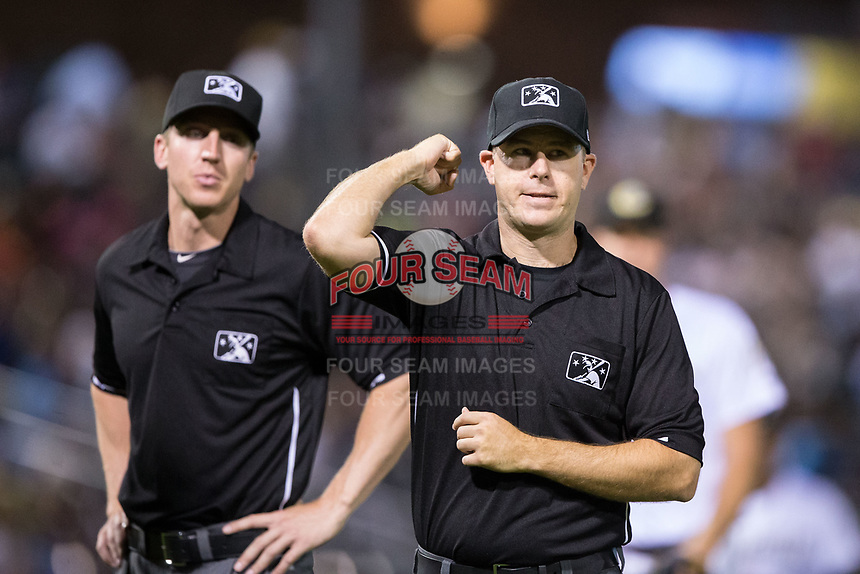First base umpire Brian Peterson makes an out call as third base umpire Alex Tosi looks on during the International League game between the Durham Bulls and the Charlotte Knights at BB&T BallPark on May 15, 2017 in Charlotte, North Carolina. The Knights defeated the Bulls 6-4.  (Brian Westerholt/Four Seam Images)