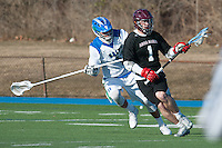 Steven Russell,'15, guards an Anna Maria offender as the Salve Regina men's lacrosse team dominates Anna Maria at Gaudet Field in Middletown.