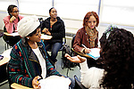 Students at Montgomery College, including Dominique Parrish, center, begin work on their group's final project in their Basic Writing II class at the Takoma Campus on Dec. 11, 2012. If students pass this class, it allows them to progress to the college level english program. Otherwise students will face the decision to take the remedial class again or drop out.