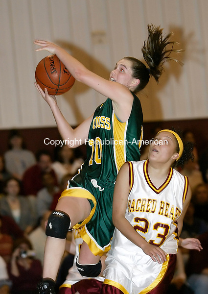 WATERBURY, CT. 16 FEBRUARY 2006- 021606BZ17-  Holy Cross Kelly McKeon (10) goes to the hoop against Sacred Heart's Jen Iglesias (23)  during their game Thursday night.<br /> Holy Cross defeated Sacred Heart 42-40 to clinch the NVL title Thursday night.<br />  Jamison C. Bazinet / Republican-American