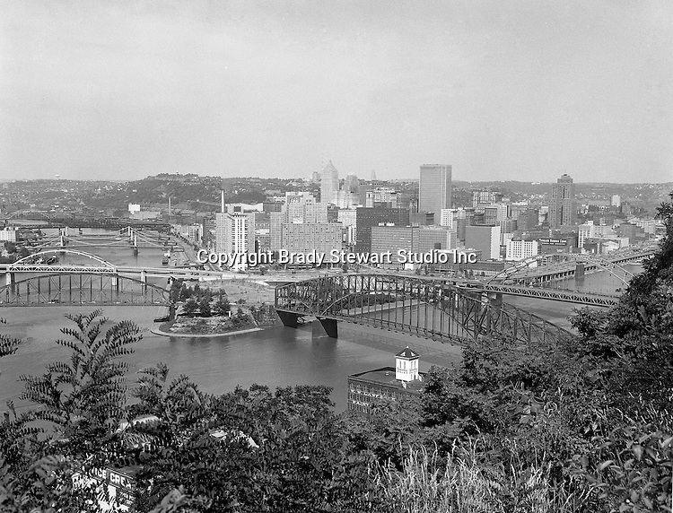 Pittsburgh PA:  View of the Point from Mount Washington - 1965.  The Gateway Towers were just built and the bridge to nowhere was almost complete.  The Point and Manchester bridges were closed to traffic in 1959 and 1969 respectively and demolished in 1970.
