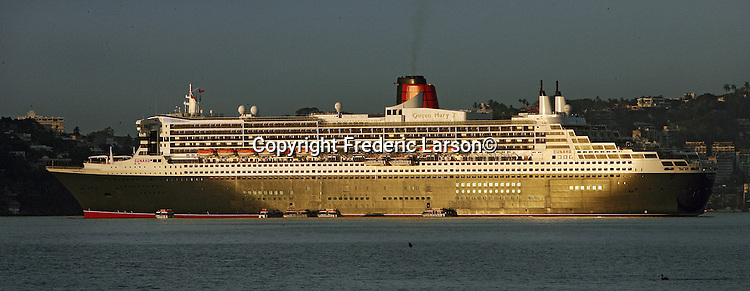 The Queen Mary II  luxury cruise liner harbored in Acapulco Bay, Mexico.