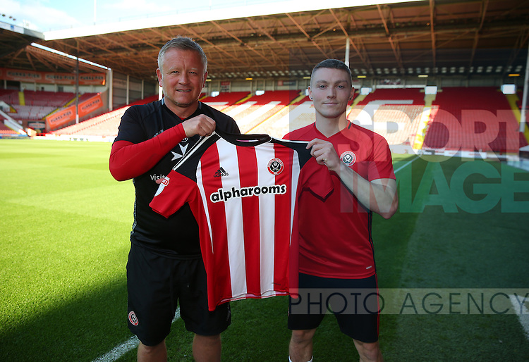 Chris Wilder manager of Sheffield Utd welcomes Caolan Lavery during the Checkatrade Trophy match at Bramall Lane Stadium, Sheffield. Picture date: August 30th, 2016. Pic Simon Bellis/Sportimage