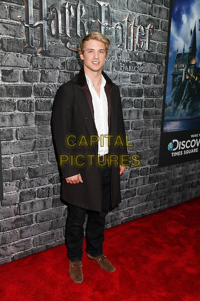 FREDDIE STROMA .Grand Opening Of Harry Potter: The Exhibition at Discovery Times Square Exposition Center, New York, New York, USA, 4th April 2011..full length black coat white shirt  jeans brown shoes .CAP/ADM/LK.©Lauren Krohn/AdMedia/Capital Pictures.