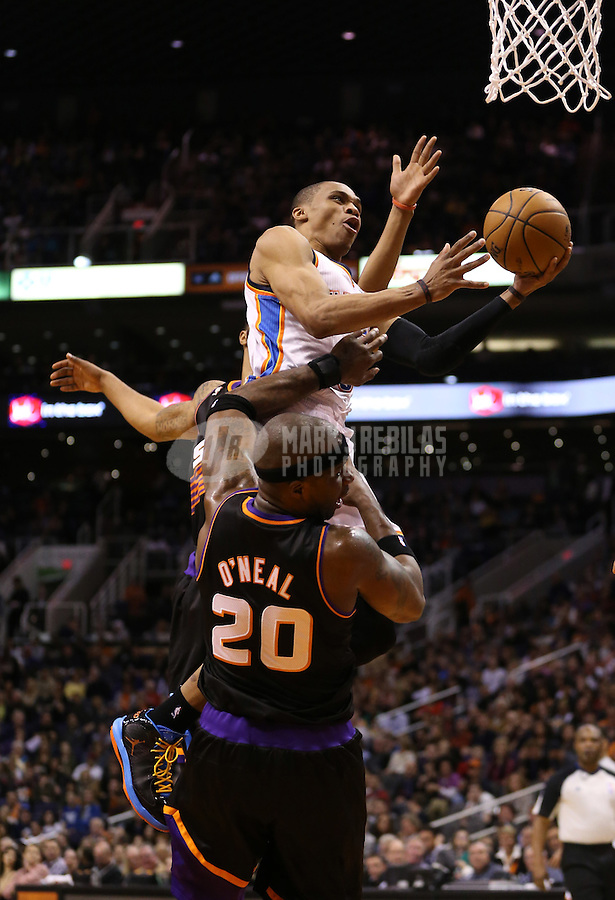 Feb. 10, 2013; Phoenix, AZ, USA: Oklahoma City Thunder point guard Russell Westbrook (0) drives to the basket against the Phoenix Suns at the US Airways Center. Mandatory Credit: Mark J. Rebilas-