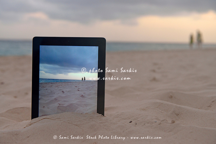 Couple at sunrise on beach filmed by a  Digital tablet in sand, Punta Cana, Dominican Republic
