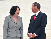 Washington, DC - September 8, 2009 -- Associate Supreme Court Justice Sonia Sotomayor  and Chief Justice of the United States John G. Roberts, Jr. share some thoughts as they pose for photos during a photo-op following the investiture ceremony in honor of Justice Sotomayor at the United States Supreme Court in Washington, D.C. on Tuesday, September 8, 2009..Credit: Ron Sachs / CNP