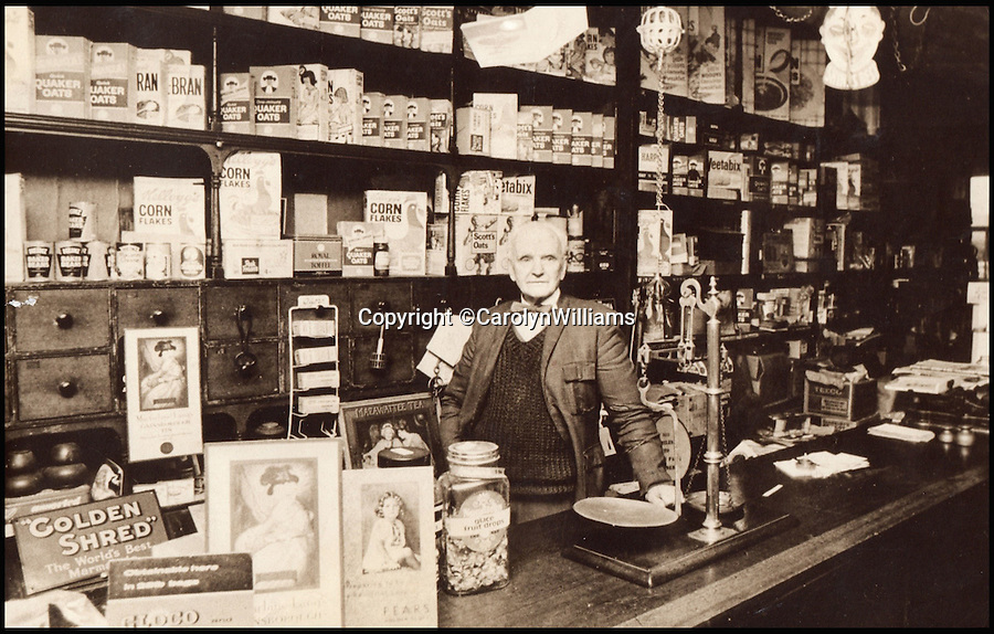 BNPS.co.uk (01202 558833)<br /> Pic: CarolynWilliams/BNPS<br /> <br /> Charles Bodman's brother Christopher returned from the war to Marshfield to run the family shop.<br /> <br /> Poignant time capsule trunk from the Great War rediscovered...<br /> <br /> An incredible 'time capsule' trunk containing the personal effects of a tragic World War One officer that his grieving family shut away in 1918 has been unearthed - almost 100 years later.<br /> <br /> The military items belonged to Second Lieutenant Charles Bodman, from Marshfield, Glos, who was killed three months before the end of the war in 1918.<br /> <br /> After his death all his possessions, including his uniforms, caps, brass badges, detailed trench maps, orders, handbooks, photographs, German souveniers, letters, water bottles, lanyard and even spent bullets, were sent back to his widowed mother Sarah who locked them away in the trunk.