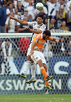 CARSON, CA - DECEMBER 01, 2012:   Omar Gonzalez (4) of the Los Angeles Galaxy heads over Will Bruin (12) of the Houston Dynamo during the 2012 MLS Cup at the Home Depot Center, in Carson, California on December 01, 2012. The Galaxy won 3-1.