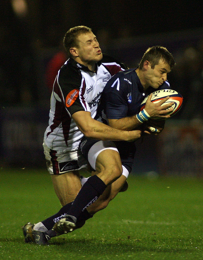 Photo: Paul Thomas..Sale Sharks v Newcastle Falcons. EDF Anglo-Welsh Cup. 29/09/2006...Newcastle's Anthony Elliot (L) tackles Oriol Ripol.