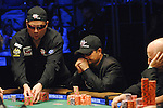 Lee Childs slies some chips in a pot against Jerry Yang.