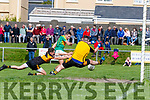 South Kerry's Chris Farley attacks the Stacks Goal but great goal keeping from Robbie Murphy denies the home side a goal as he gets his leg out to block this shot.