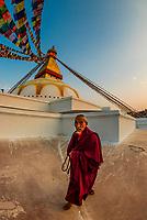 Buddhist pilgrims circumambulate the massive Boudhanath Stupa (the largest stupa in Nepal and the holiest Tibetan Buddhist temple outside Tibet.) The Boudhanath Temple is the center of Tibetan culture in Kathmandu, Nepal.