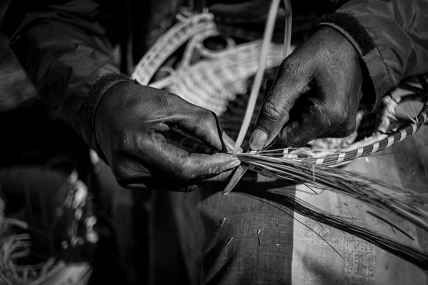 Eugene Gilliard, 60, sews sweetgrass baskets along U.S. Highway 17 in Mt. Pleasant. Traditionally the baskets were made by Gullah men but now it is usually women who practice the craft. Gilliard began sewing in 1990, and he lives in an area known as 7 mile.