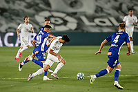 10th July 2020; Estadio Alfredo Di Stefano, Madrid, Spain; La Liga Football, Real Madrid versus Deportivo Alaves; Marco Asensio (Real Madrid)  is fouled on the ball by Camarasa of Alaves