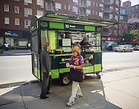 TD Bank sponsored cart distributes drinks and treats at the grand opening of a new branch in the Chelsea neighborhood of New York on Friday, September 18, 2015. TD Bank has seen growth recently through expansion of its retail banking network and the acquisition of other banks. (© Richard B. Levine)