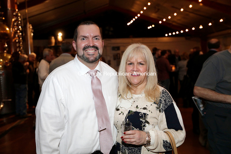 Litchfield, CT- 05 May 2016-050516CM15-  From left, Steve Criss chairman of the event and Pamela Root of Harwinton  are photographed during Bourbon and Bluegrass, A Tasting to Benefit the Northwest Connecticut Arts Council at Litchfield Distillery on Friday May 6.     Christopher Massa Republican-American