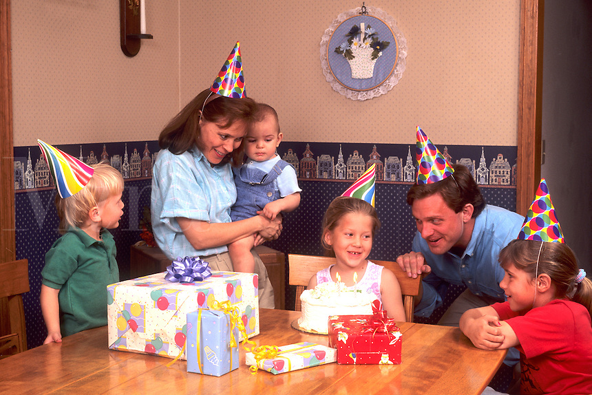 American family celebrating daughters birthday party at home