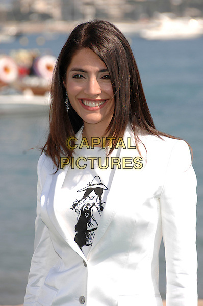 "CATERINA MURINO.""St Trinian's"" photocall at the British Pavillion.60th International Cannes Film .Cannes, France  20th May 2007.half length white jacket black school girl motif top.CAP/PL.©Phil Loftus/Capital Pictures"