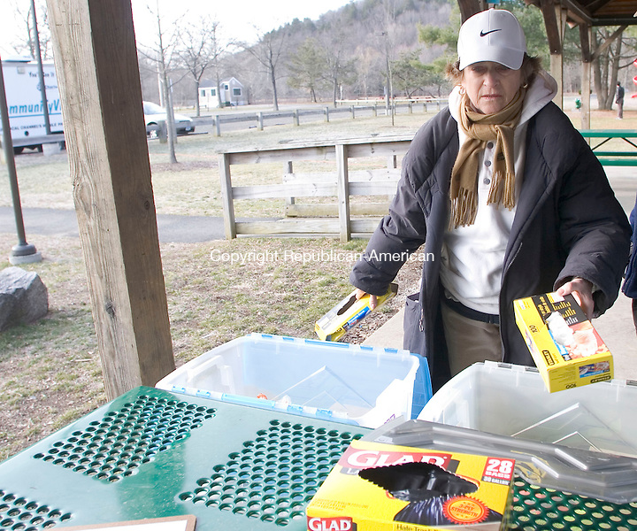 WOODBURY, CT - 07 APRIL 2007 - 040707JW10.jpg -- Coordinator Claudette Vollage sets out boxes of plastic bags and gloves for volunteers during the town of Woodburys annual spring townwide cleanup Saturday morning. Jonathan Wilcox Republican-American