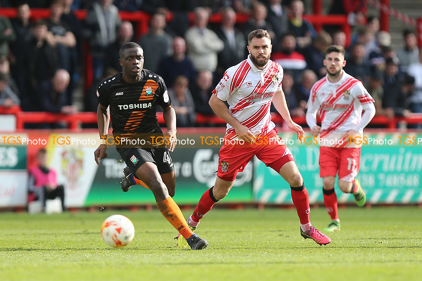 David Tutonda of Barnet and Josh McQuoid of Stevenage during Stevenage vs Barnet, Sky Bet EFL League 2 Football at the Lamex Stadium on 1st April 2017