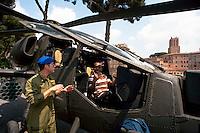 Roma 4  Maggio 2011. Mezzi militariin piazza Venezia per i 150° dell'anniversario della costituzione dell'Esercito Italiano..L'elicottero A129 Mangusta, un turista prova il posto di guida.