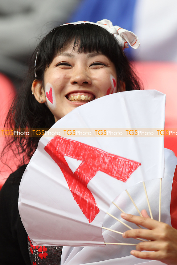 A Japanese fan is seen prior to kick-off - France Women vs Japan Women - Womens Olympic Football Tournament London 2012 Semi-Final at Wembley Stadium - 06/08/12 - MANDATORY CREDIT: Gavin Ellis/SHEKICKS/TGSPHOTO - Self billing applies where appropriate - 0845 094 6026 - contact@tgsphoto.co.uk - NO UNPAID USE.