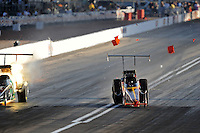 Mar. 31, 2012; Las Vegas, NV, USA: NHRA top alcohol dragster driver James Butler (right) crosses the center line and takes out the timing blocks alongside Greg Hunter during qualifying for the Summitracing.com Nationals at The Strip in Las Vegas. Mandatory Credit: Mark J. Rebilas-US PRESSWIRE