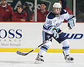 Jon Swavely (Maine - 18) - The University of Maine Black Bears defeated the University of New Hampshire Wildcats 5-4 in overtime on Saturday, January 7, 2012, at Fenway Park in Boston, Massachusetts.