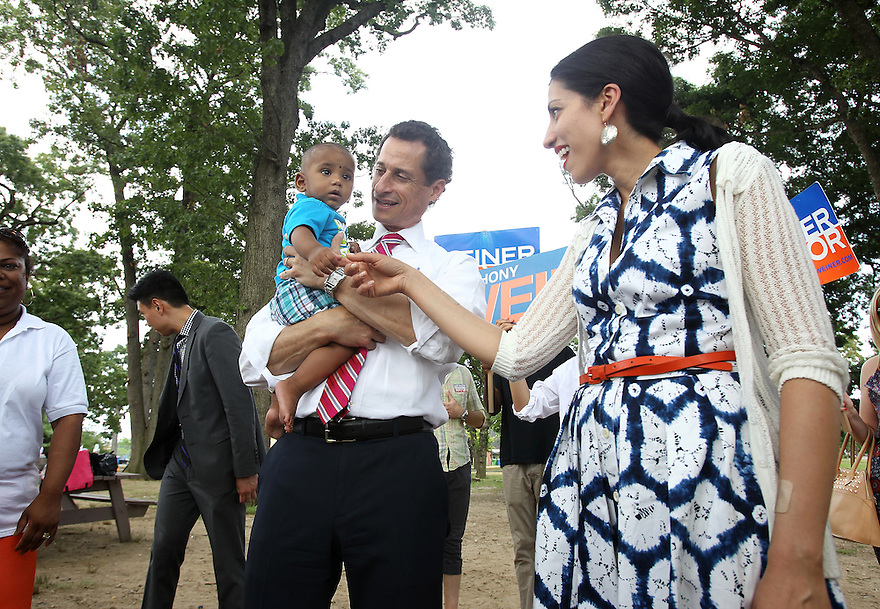 Anthony Weiner left, along with wife Huma Abedin attend the Jamaica Jerk Festival at Roy Wilkins Park in Queens on Sunday, July 21, 2013. (AP Photo/ Donald Traill)