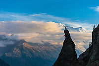 Climbers celebrating on top of the Aiguillette d'Argentiere with the Mont Blanc massive in the background.