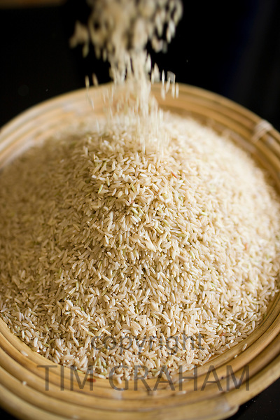 Bamboo basket of brown wholegrain rice. Rice has become an expensive commodity as its in short supply.