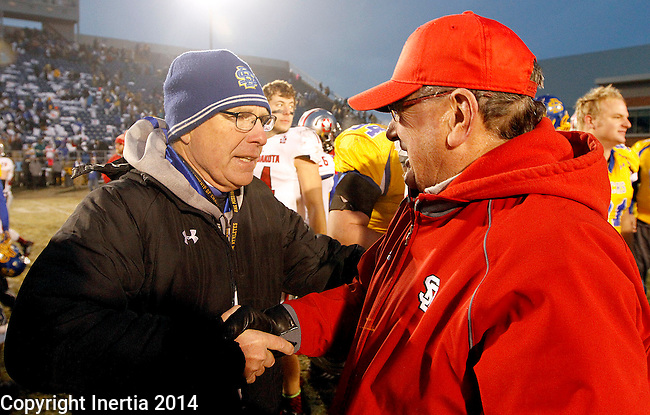 BROOKINGS, SD - NOVEMBER 22: South Dakota State University head coach John Stiegelmeier shakes hands with Joe Glenn from the University of South Dakota following the Jacks win over the Coyotes 37 - 14 at Coughlin Alumni Stadium Saturday in Brookings.  (Photo by Dave Eggen/Inertia)