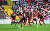 Lincoln City's John Akinde scores the opening goal from the penalty spot<br /> <br /> Photographer Chris Vaughan/CameraSport<br /> <br /> The EFL Sky Bet League Two - Lincoln City v Swindon Town - Saturday 11th August 2018 - Sincil Bank - Lincoln<br /> <br /> World Copyright &copy; 2018 CameraSport. All rights reserved. 43 Linden Ave. Countesthorpe. Leicester. England. LE8 5PG - Tel: +44 (0) 116 277 4147 - admin@camerasport.com - www.camerasport.com