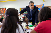 New Orleans, LA - October 15, 2009 -- United States President Barack Obama has a discussion with students during a visit to the Dr. Martin Luther King Jr. Charter School in New Orleans, Louisiana, October 15, 2009. .Mandatory Credit: Pete Souza - White House via CNP