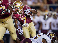TALLAHASSEE, FLA. 9/5/15-Florida State University's Mario Pender dodges a Texas State University defender during first half action in the football game at Doak Campbell Stadium in Tallahassee.<br /> <br /> COLIN HACKLEY PHOTO