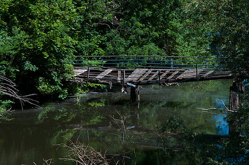 Old burned out mill at Halle Germany. Old bridge once going to the mill.