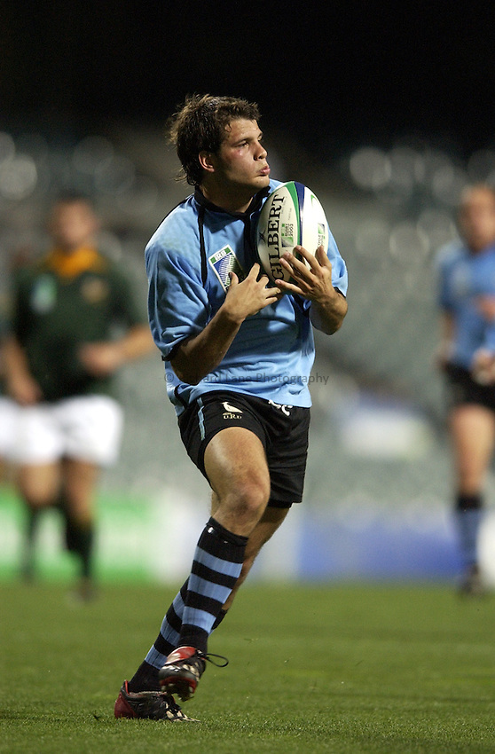 Photo: Richard Lane..South Africa v Uruguay, Pool C at the Subiaco Oval, Perth. RWC 2003. 11/10/2003. .Joaquin Pastore takes a high ball.