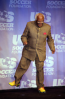 Archbishop Desmond Tutu tries a pair of personalized soccer cleats that were presented to him by Adidas on for size during the US Soccer Foundation Gala held at City Center in Washington, DC.