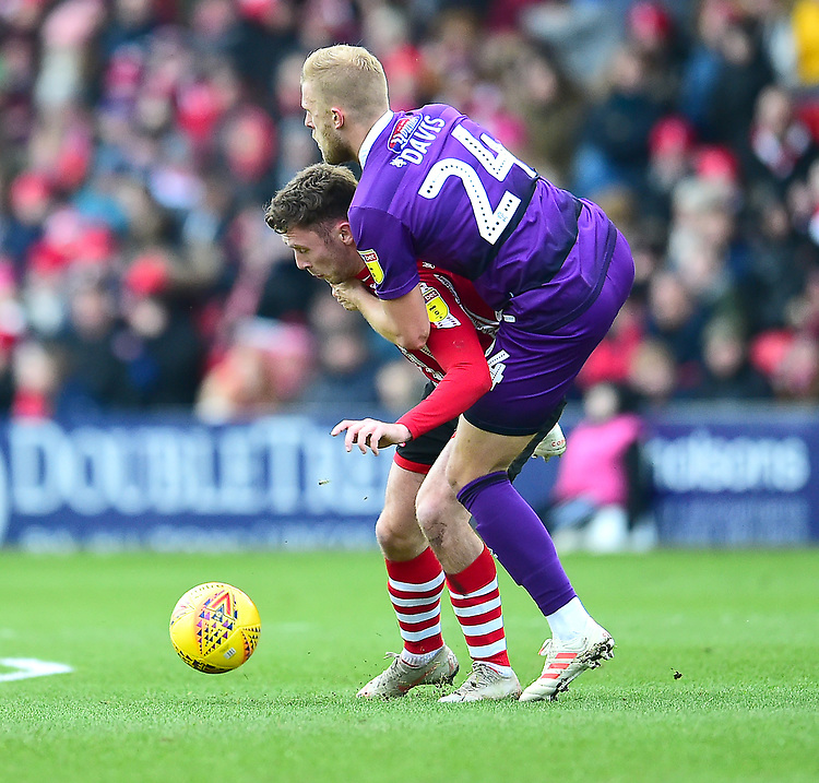Lincoln City's Shay McCartan battles with Grimsby Town's Harry Davis<br /> <br /> Photographer Andrew Vaughan/CameraSport<br /> <br /> The EFL Sky Bet League Two - Lincoln City v Grimsby Town - Saturday 19 January 2019 - Sincil Bank - Lincoln<br /> <br /> World Copyright &copy; 2019 CameraSport. All rights reserved. 43 Linden Ave. Countesthorpe. Leicester. England. LE8 5PG - Tel: +44 (0) 116 277 4147 - admin@camerasport.com - www.camerasport.com