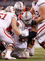 Ohio State Buckeyes defensive tackle Michael Bennett (53) sacks Wisconsin Badgers quarterback Joel Stave (2) during the second quarter of the Big Ten Championship game at Lucas Oil Stadium in Indianapolis on Dec. 6, 2014. (Adam Cairns / The Columbus Dispatch)