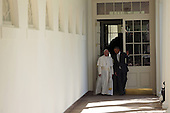 U.S. President Barack Obama (R) escorts Pope Francis (L) down the West Wing colonnade walk during the arrival ceremony at the White House on September 23, 2015 in Washington, DC. The Pope begins his first trip to the United States at the White House followed by a visit to St. Matthew's Cathedral, and will then hold a Mass on the grounds of the Basilica of the National Shrine of the Immaculate Conception.<br /> Credit: Alex Wong / Pool via CNP