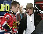 Greg Biffle, left, talks with team owner Jack Rousch in the garage area at Daytona International Speedway, in Daytona Beach, Fla., between NASCAR NEXTEL Cup practice sessions, Saturday, Feb. 11, 2006.(AP Photo/Brian Myrick)