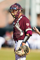 Catcher Jimmy Holton #11 of the College of Charleston Cougars looks to the dugout for a sign during the game against the Davidson Wildcats at Wilson Field on March 12, 2011 in Davidson, North Carolina.  The Wildcats defeated the Cougars 8-3.  Photo by Brian Westerholt / Four Seam Images
