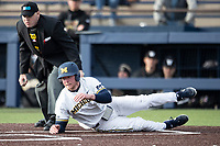 Michigan Wolverines outfielder Miles Lewis (3) slides home against the Western Michigan Broncos on March 18, 2019 in the NCAA baseball game at Ray Fisher Stadium in Ann Arbor, Michigan. Michigan defeated Western Michigan 12-5. (Andrew Woolley/Four Seam Images)