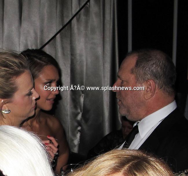 Lindsay Lohan and Kim Kardashian at the Weinstein Golden Globes after party. <br /><br />Pictured: Jessica Alba, Harvey Weinstein<br /><br />Ref: SPL350870  150112  <br />Picture by: CelebrityVibe / Splash News<br /><br />Splash News and Pictures<br />Los Angeles:310-821-2666<br />New York:212-619-2666<br />London:870-934-2666<br />photodesk@splashnews.com