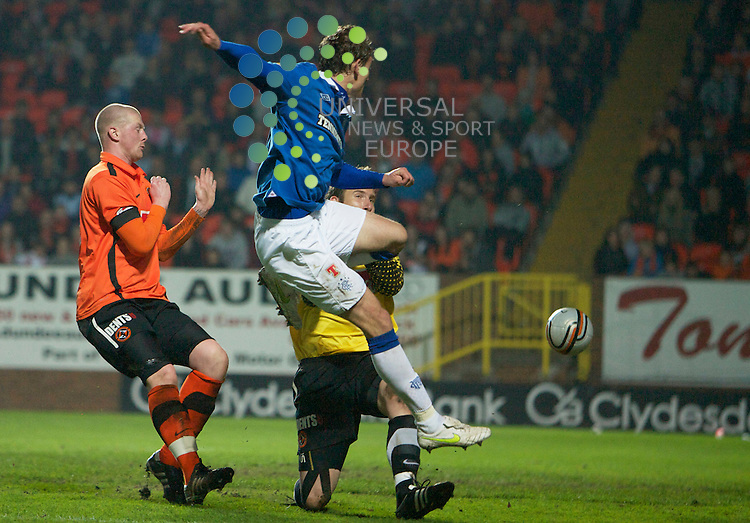 The Clydesdale Bank Scottish Premier League, Season 2010/11.Dundee United Football Club  V  Rangers Football Club..19-04-11... Nikica Jelavic  scoring to make it 3-0 to Rangers    , in this evening's Scottish Premier League game between, Scottish Premier League sides Dundee United and title chasing Rangers...At Tannadice Stadium, Dundee...Picture, Mark Davison/Universal News and Sport (Scotland) .Tuesday 19th April 2011.