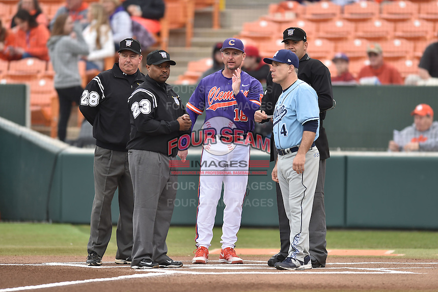 (L-R) First base umpire David Savage, third base umpire Kenneth Fitts, Clemson Tigers head coach Monte Lee (18), Main Black Bears head coach Steve Trimper and home plate umpire Jay Pierce discuss lineups and ground rules before a game between the Maine Black Bears and the Clemson Tigers at Doug Kingsmore Stadium on February 20, 2016 in Clemson, South Carolina. The Tigers defeated the Black Bears 9-4. (Tony Farlow/Four Seam Images)